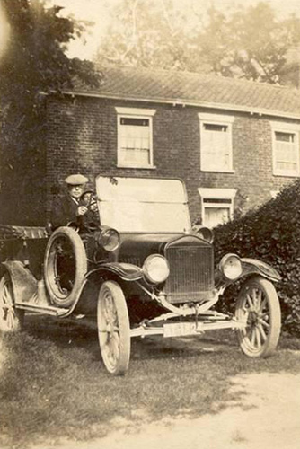 "This is Mr John Wright at ""The Elms"" in his Ford Model T known as the Tin Lizzie."